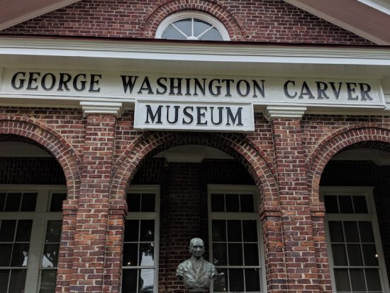 Tom and Peggy standing in front of the George Washington Carver Museum